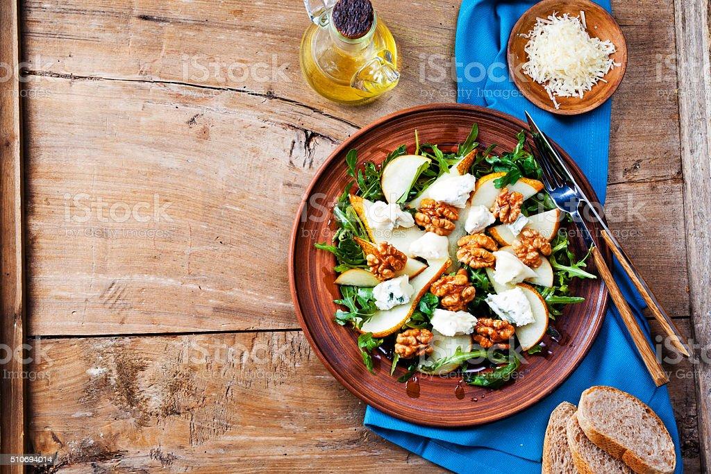 salad bowl with gorgonzola, arugula, walnuts and pear stock photo