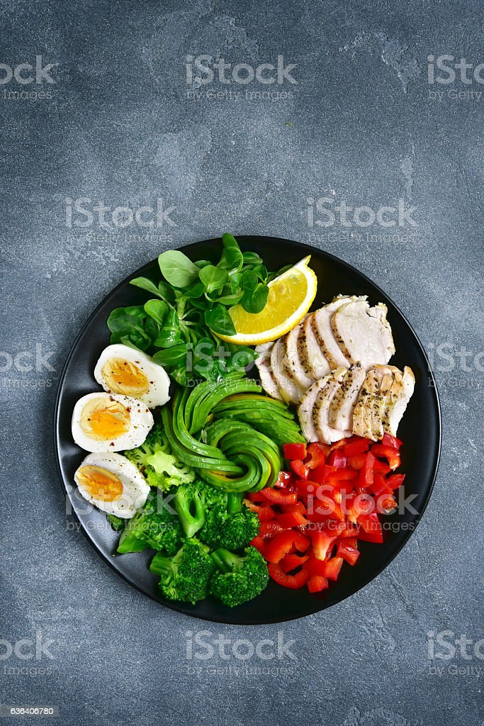 Salad bowl with vegetables,lamb lettuce and chicken.Top view. stock photo