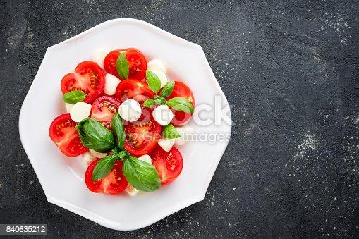 Salad caprese. Healthy eating vegetable vegetarian food. Top view, copy space