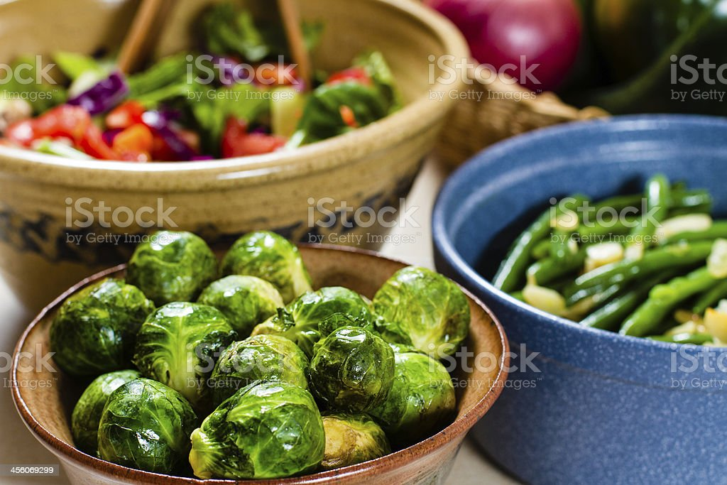 Salad, cooked Brussels Spout & Green Beans in ceramic bowls. royalty-free stock photo