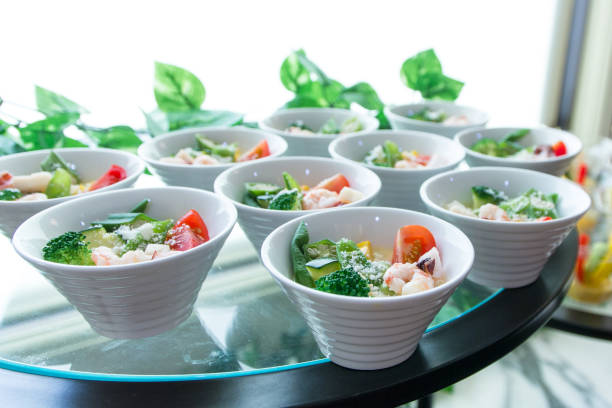 salad dish, catering - serving size stock photos and pictures