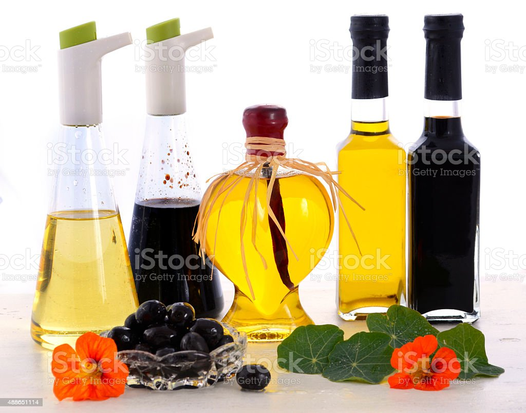 Salad Dressing with oils, olives and vinegars stock photo