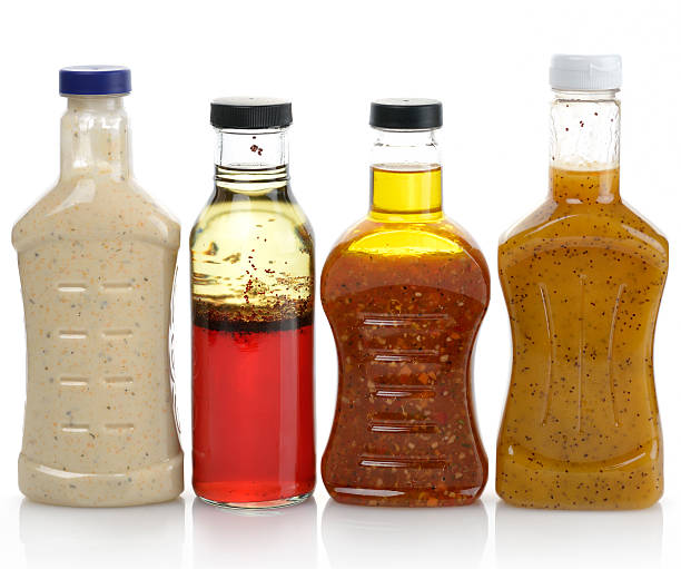 Salad Dressings Assortment Of Salad Dressing Bottles salad dressing stock pictures, royalty-free photos & images