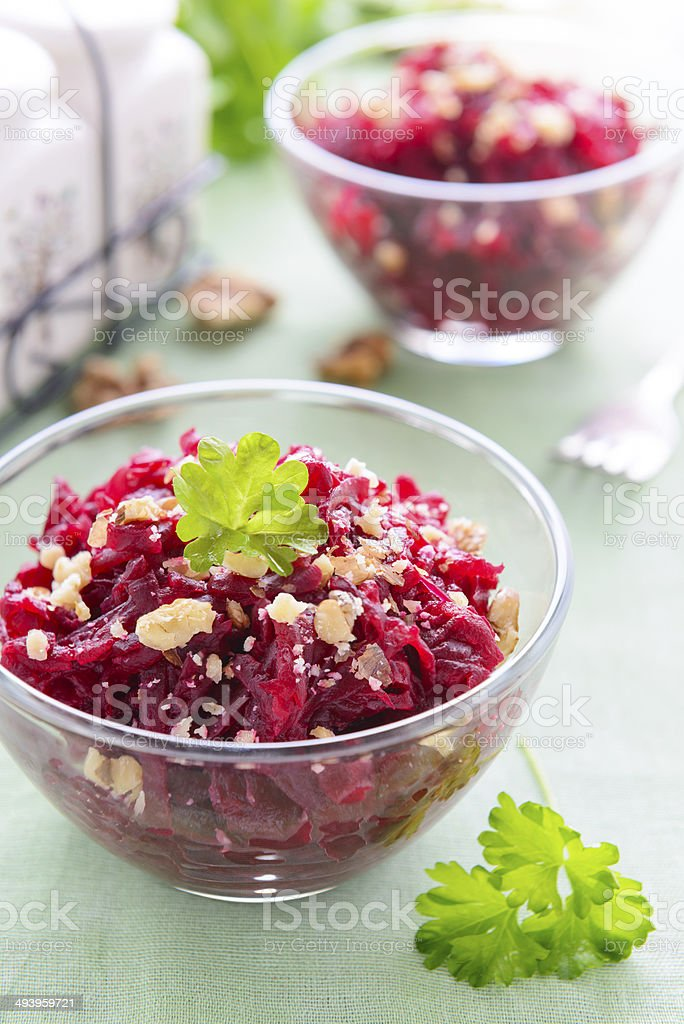 Salad from beetroot and walnuts stock photo