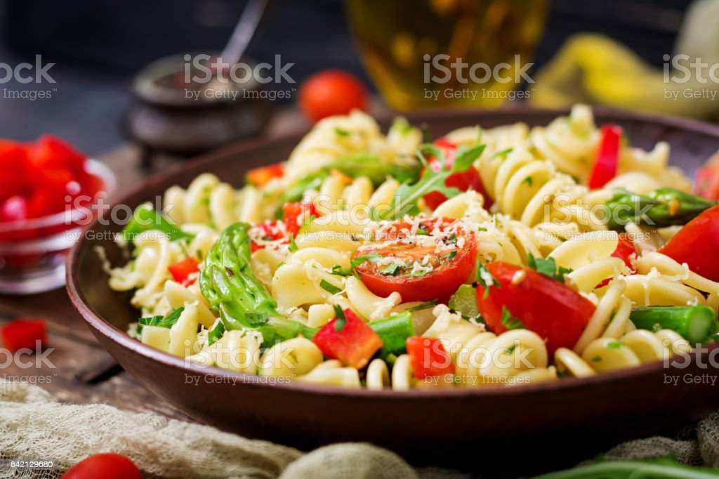 Salad - fusilli pasta with tomatoes, asparagus and sweet pepper stock photo