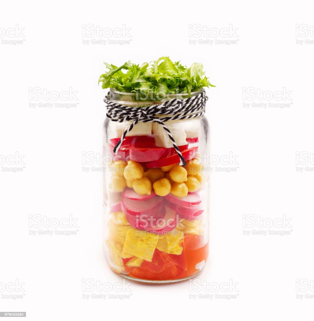 Salad in a jar isolated on white background. stock photo
