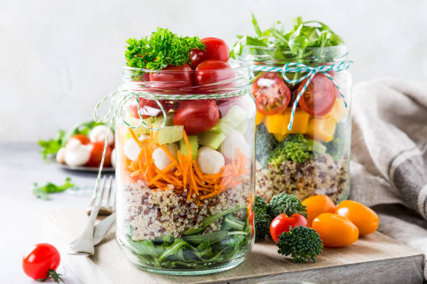 Salad in glass jar with quinoa stock photo