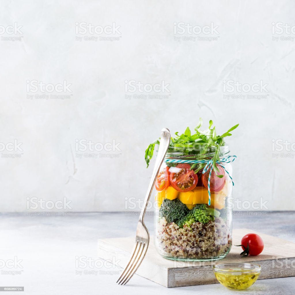 Salad in glass jar with quinoa royalty-free stock photo