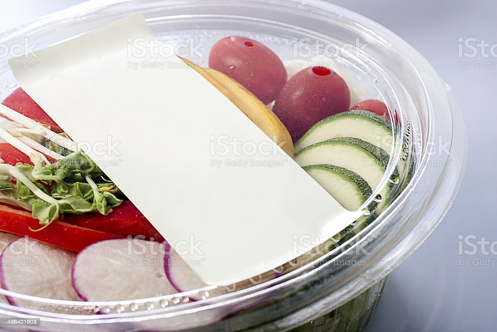 Salad in plastic packaging. stock photo