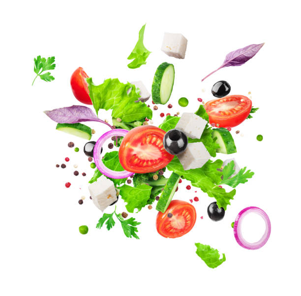 Salad ingredients are flying isolated on a white background. Healthy nutrition stock photo