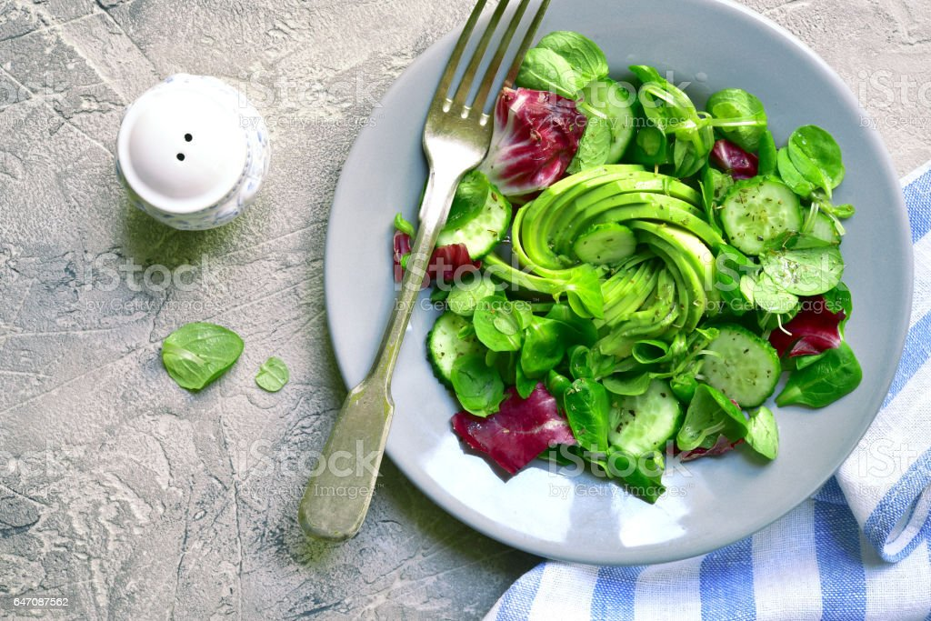 Salad leaves mix with avocado and cucumber stock photo