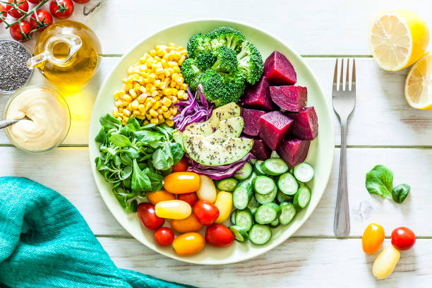 Salad mix plate shot from above on light green picnic table stock photo