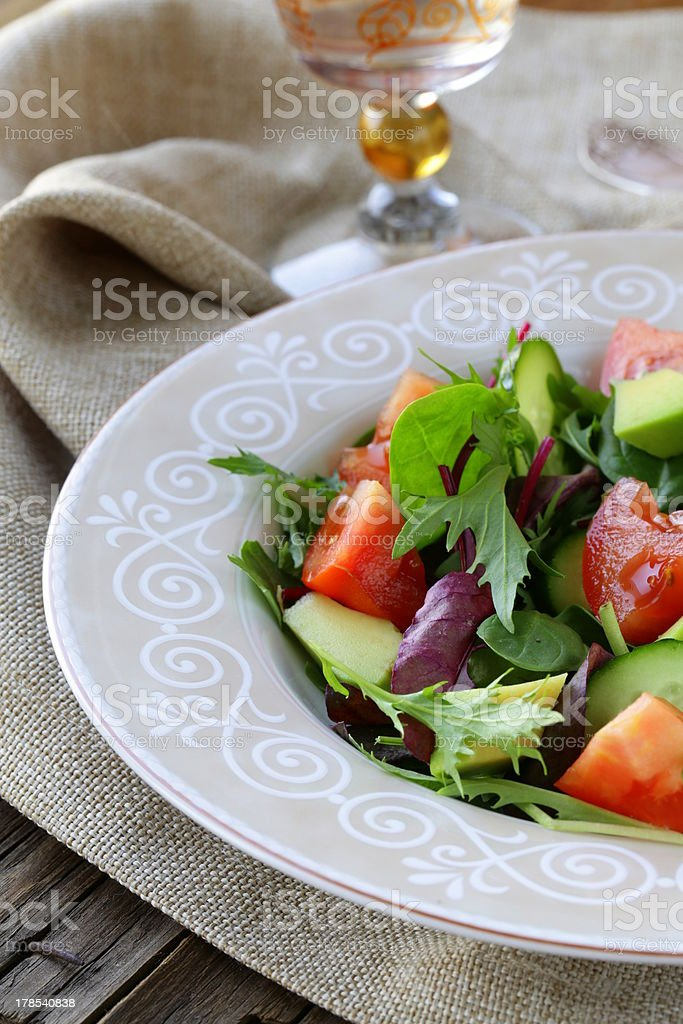 salad mix with avocado, tomato and cucumber royalty-free stock photo