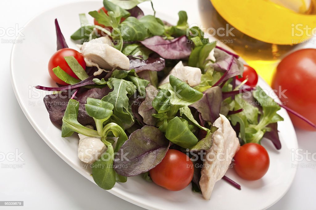 salad mix with chicken breast and cherry tomatoes royalty-free stock photo