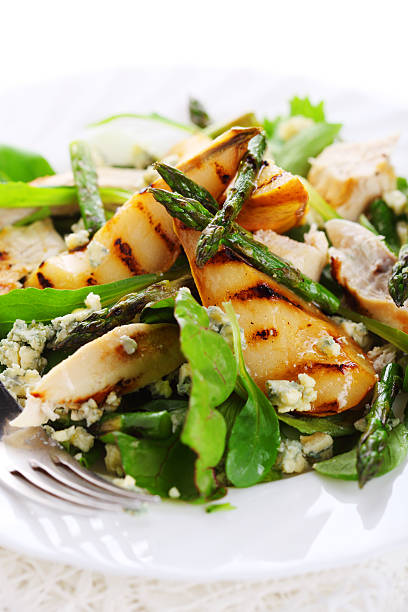 Salad mix with pears, grilled asparagus and blue cheese stock photo