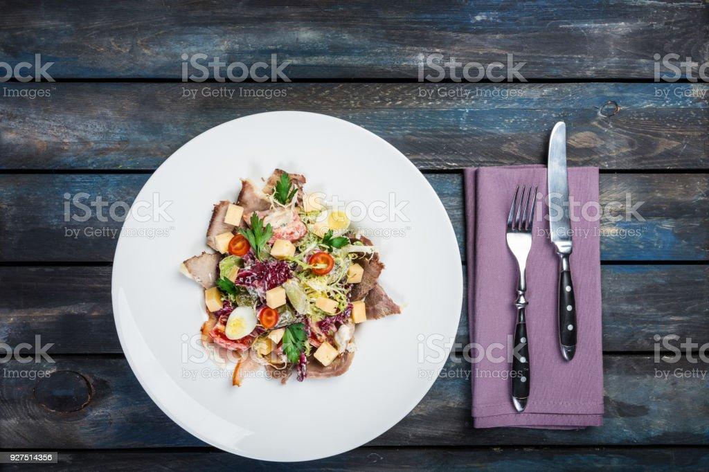 Salad. Mixed lettuce, tomatoes, turkey smoked, smoked duck, dried horsemeat stock photo
