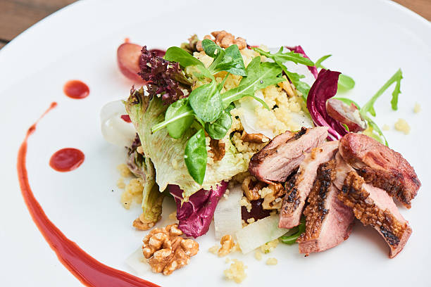 Salad of duck breast, daikon, grapes and couscous – Foto