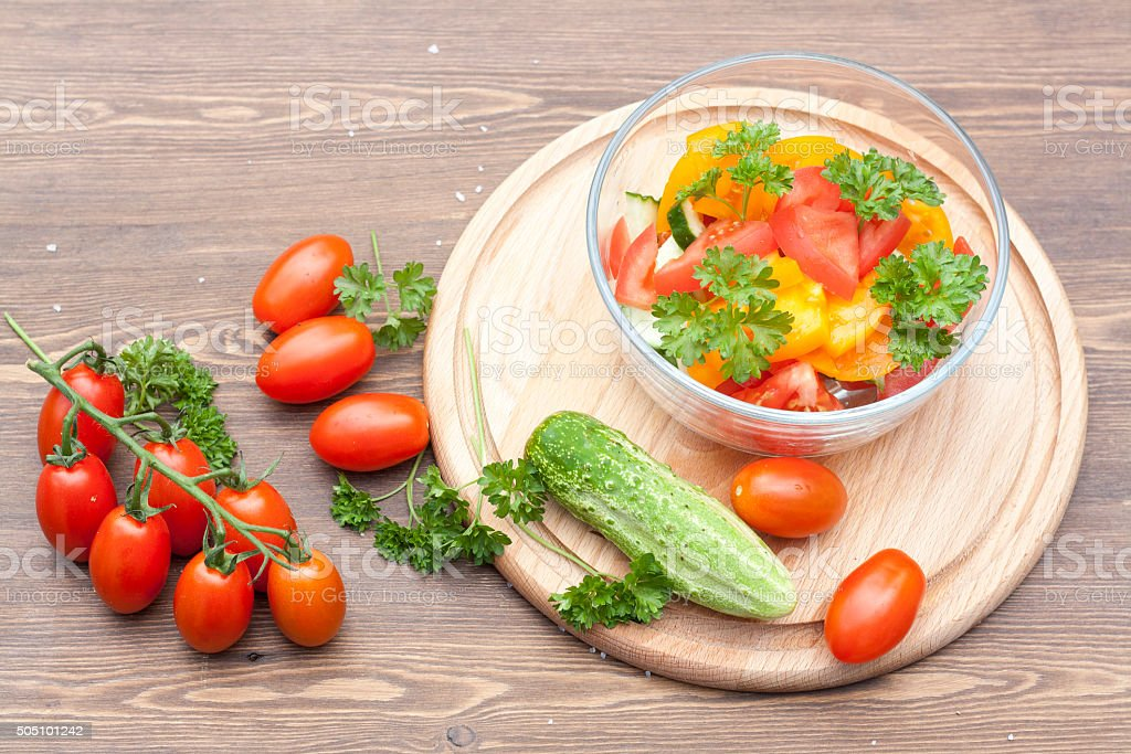 Salad of fresh yellow and pink tomatoes royalty-free stock photo