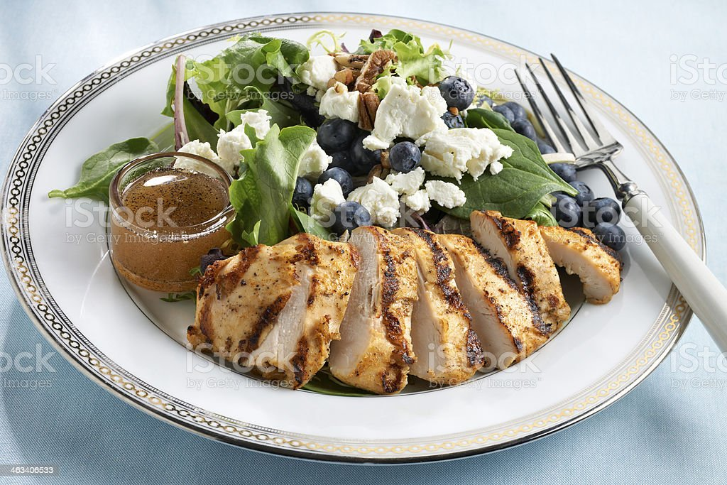 Salad of Grilled Chicken, lettuce, blueberries and goat cheese stock photo