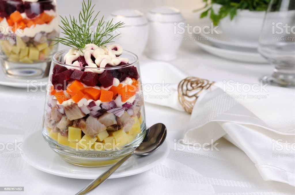 Salad of herring with vegetables stock photo
