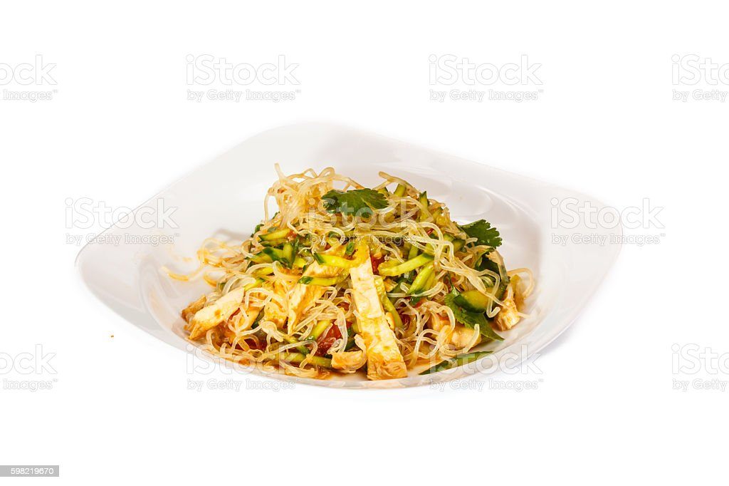 Salad of rice noodles, chicken and vegetables is in the foto royalty-free