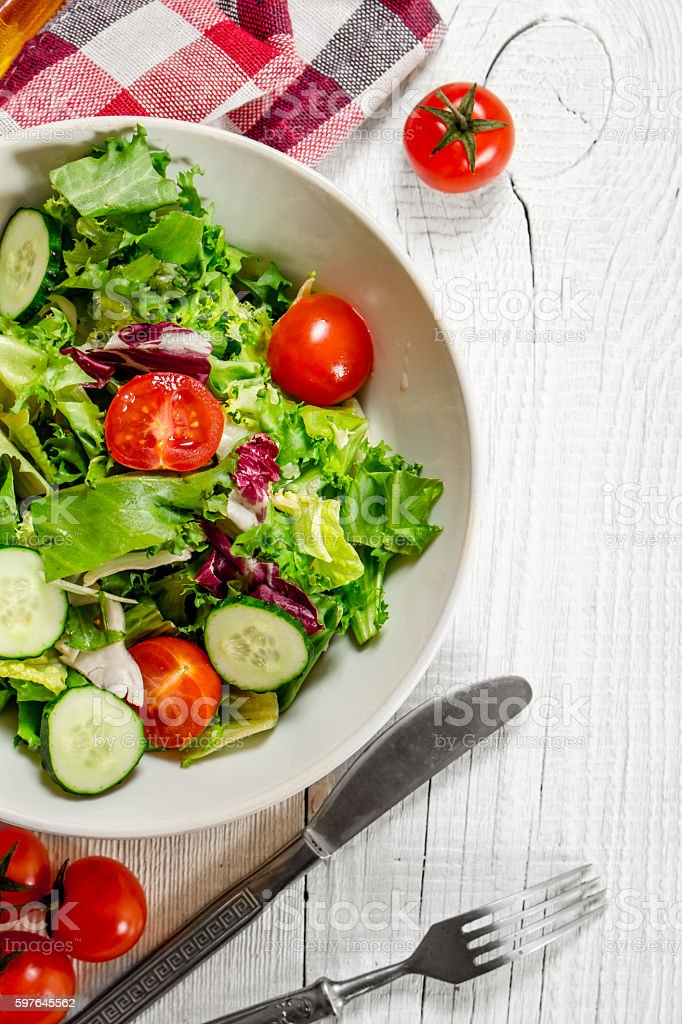 Salad of tomatoes and cucumbers with greens . - Royalty-free Arugula Stock Photo