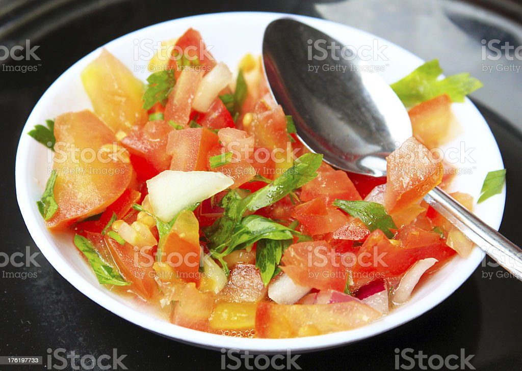 Salad of tomatoes, onion and greens royalty-free stock photo