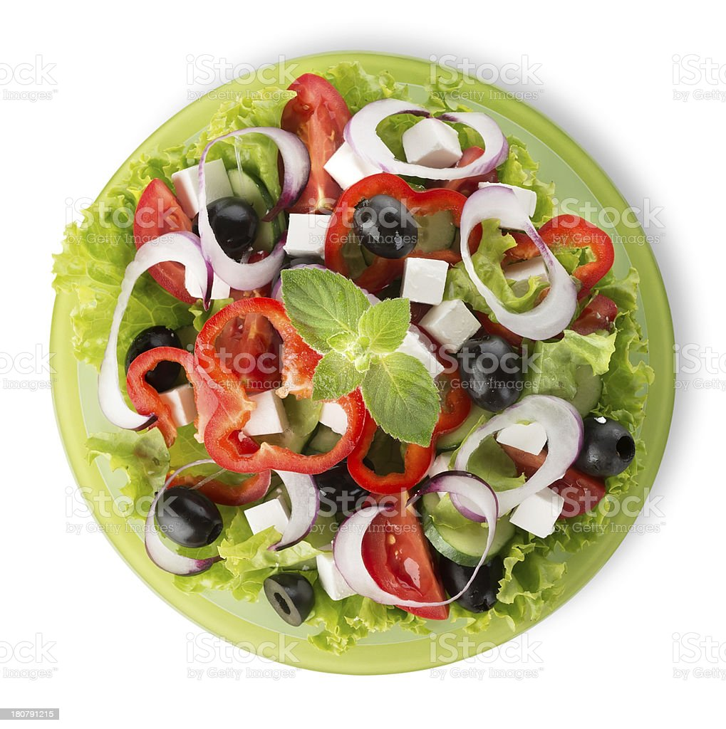 Salad on a green plate royalty-free stock photo