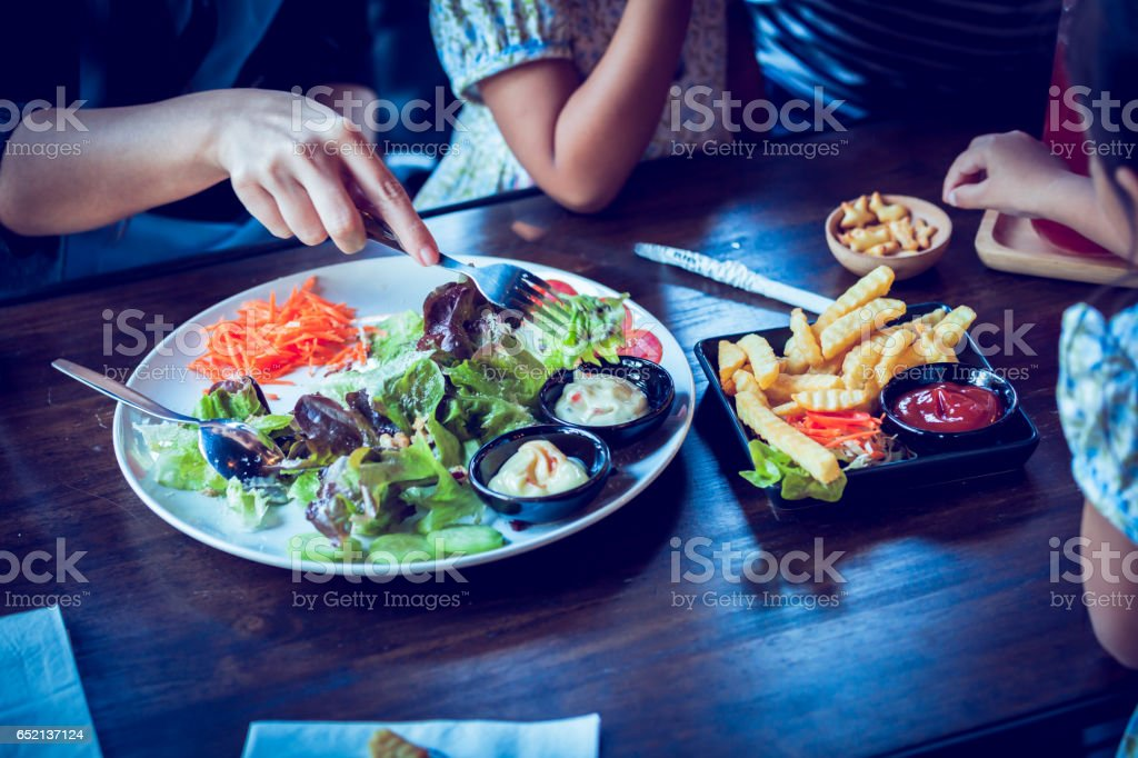 Salad on table with customer in cafe stock photo