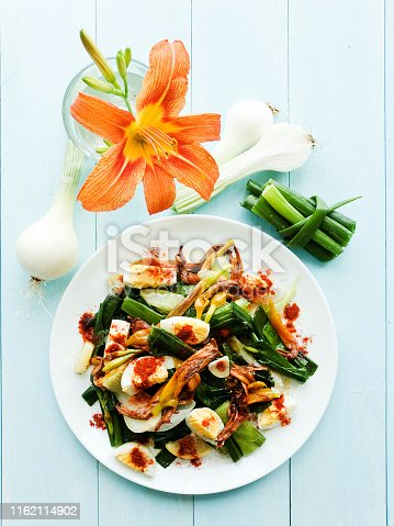 Daylily flowers salad with boiled eggs. Shallow dof.
