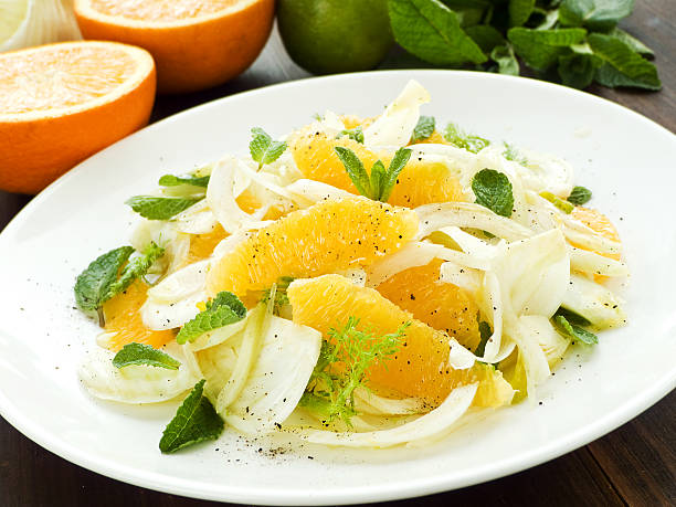 Salad Fresh salad with fennel, orange and mint. Shallow dof. fennel stock pictures, royalty-free photos & images