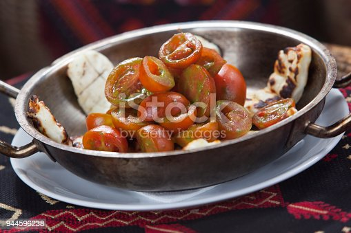 879977192 istock photo salad plate for healthy people, grilled cheese with fresh tomatos 944596238