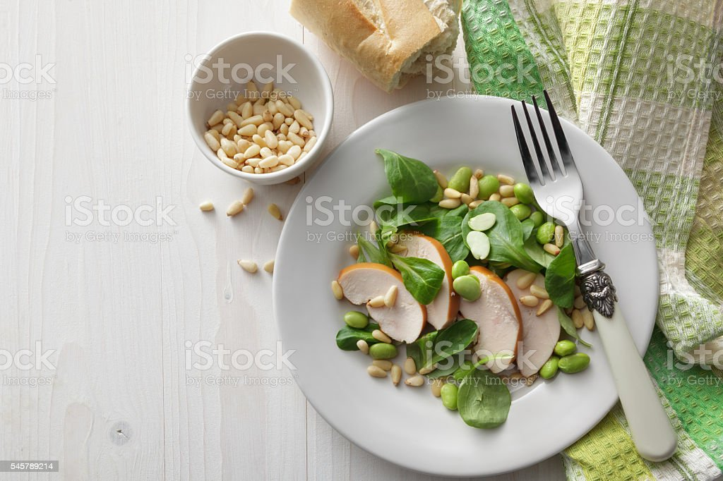 Salad Stills: Chicken, Corn Salad, Soy Beans and Pine Nuts stock photo