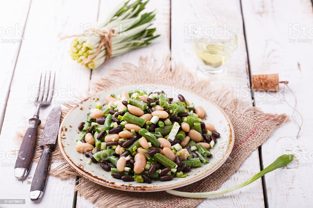 Salad three-bean with garlic stock photo
