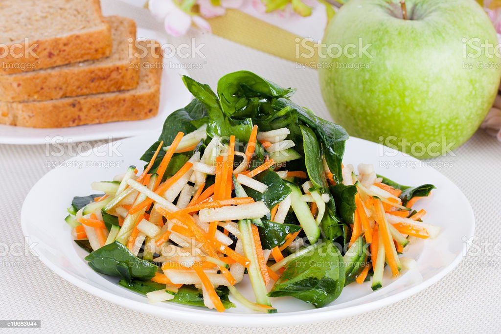 salad with apple and carrot stock photo