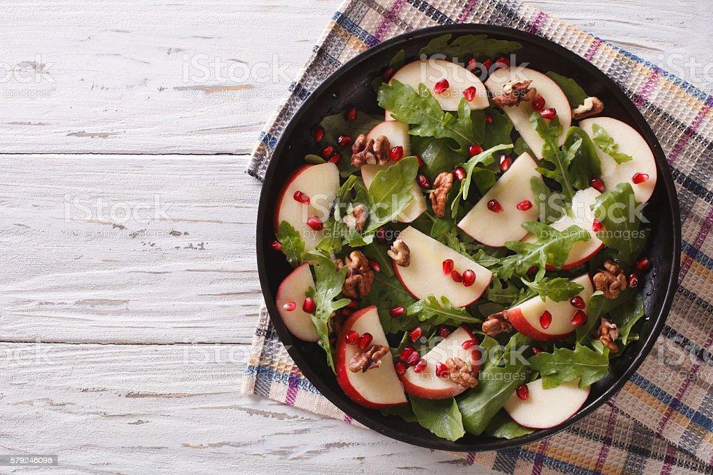 salad with apples, pomegranates, walnut and arugula. horizontal stock photo