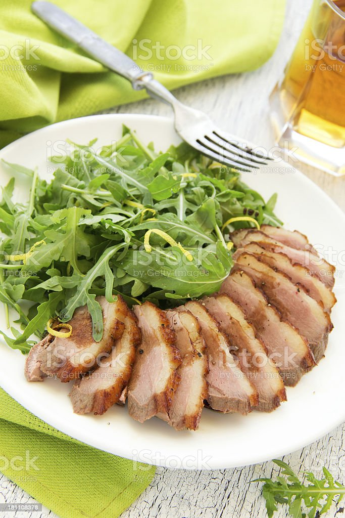 Salad with arugula and duck breast. royalty-free stock photo