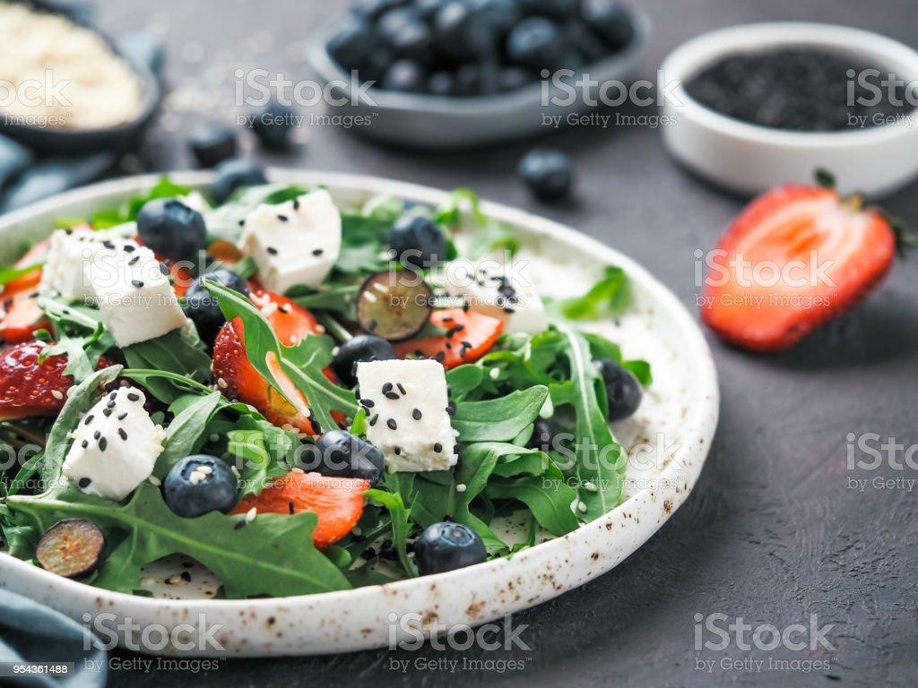 Salad with arugula, feta, strawberry, blueberry stock photo