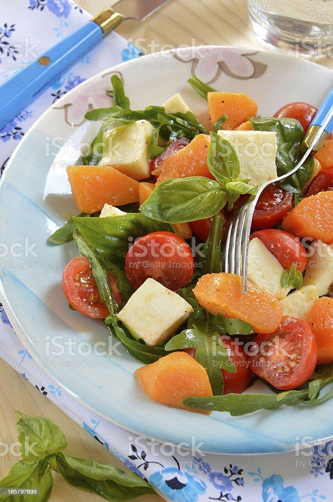 Salad with arugula, mozzarella, and marinated pumpkin royalty-free stock photo