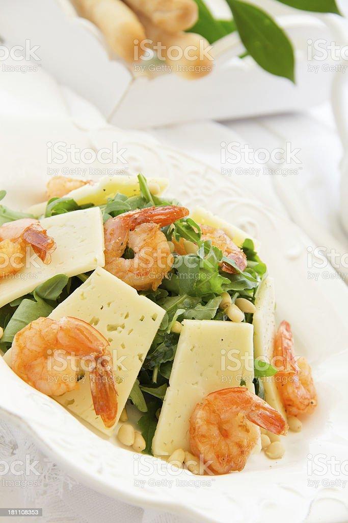 Salad with arugula, shrimp and parmesan cheese. royalty-free stock photo
