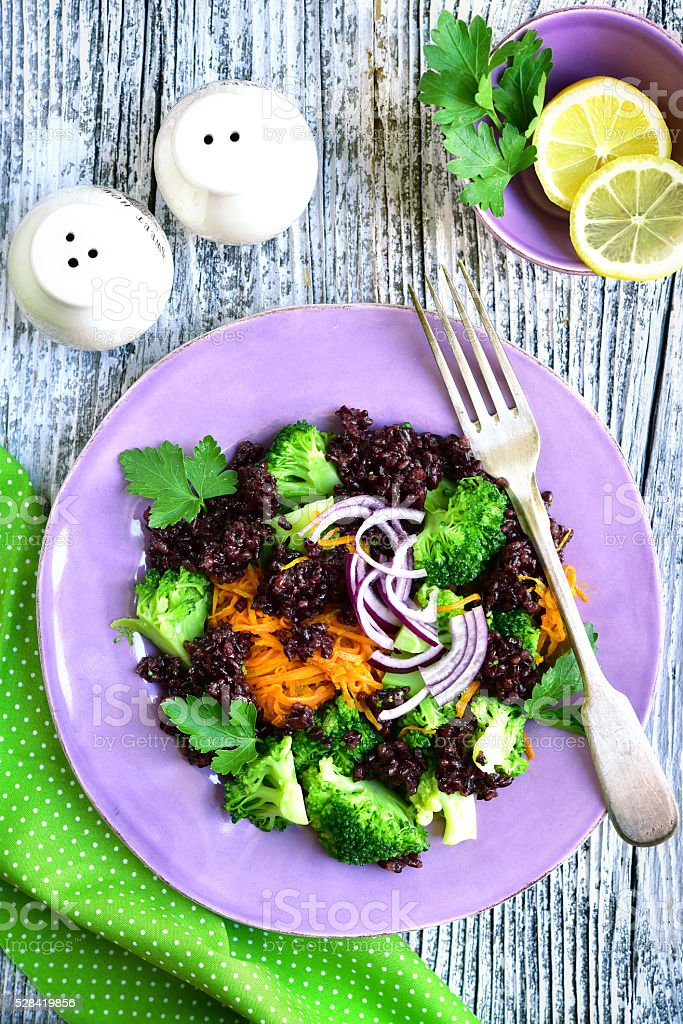 Salad with black rice,carrot and broccoli. stock photo