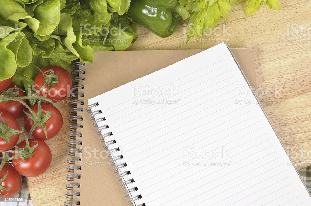Salad with blank recipe book and chopping board royalty-free stock photo