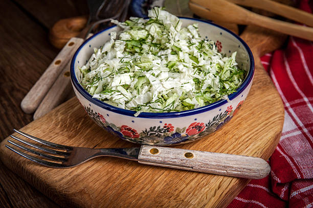 salad with cabbage and dill. - kohlsalate stock-fotos und bilder