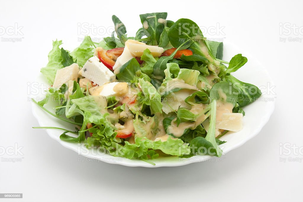Salad with cheese and French dressing royalty-free stock photo
