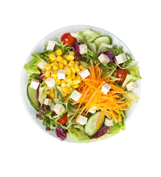 Salad with cheese and fresh vegetables isolated on white background stock photo