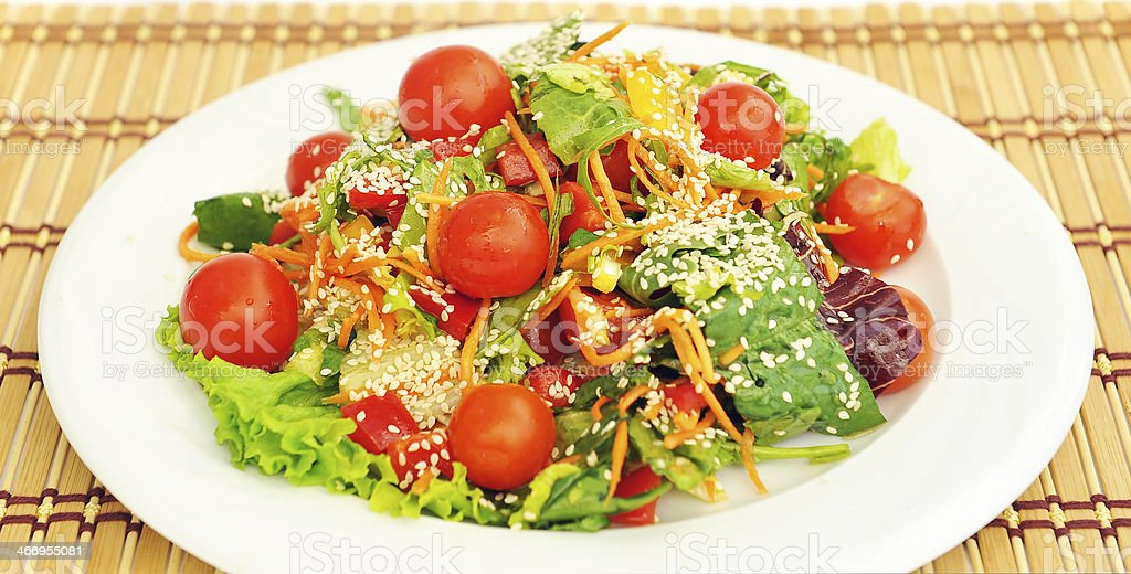 Salad with cherry tomatoes and sesame seeds. royalty-free stock photo