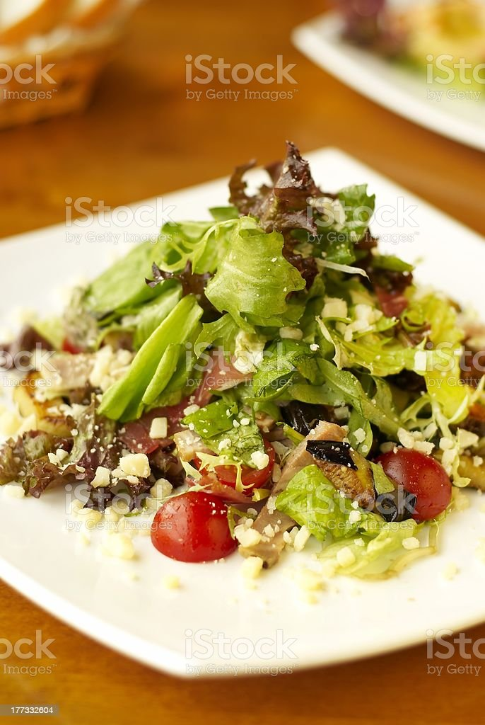 Salad with cherry tomatoes, cheese and nuts royalty-free stock photo