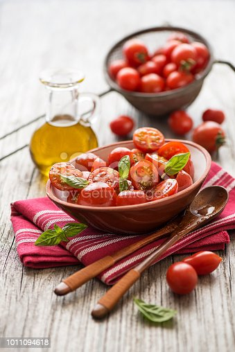 Salad with cherry tomatoes. Home made food. Concept for a tasty and healthy meal.
