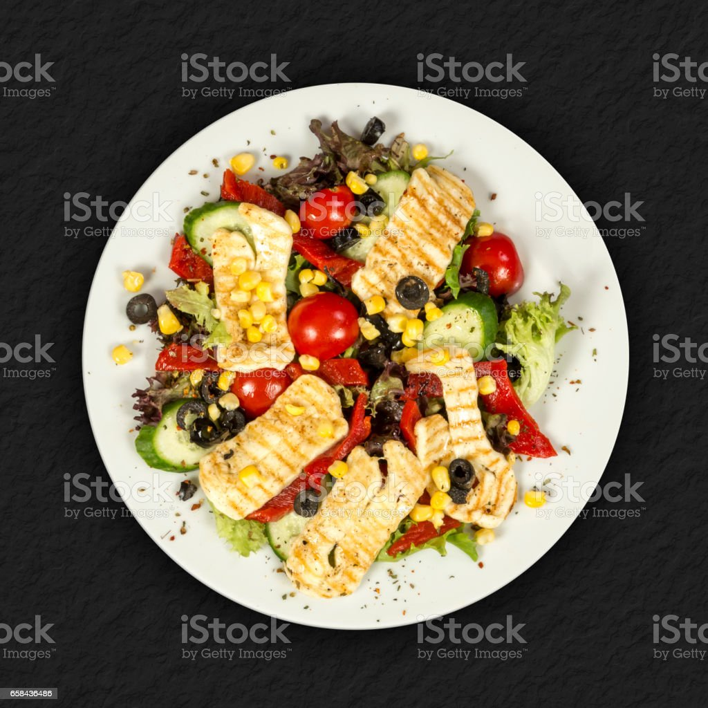 Salad with chicken and vegetables on white plate'n stock photo