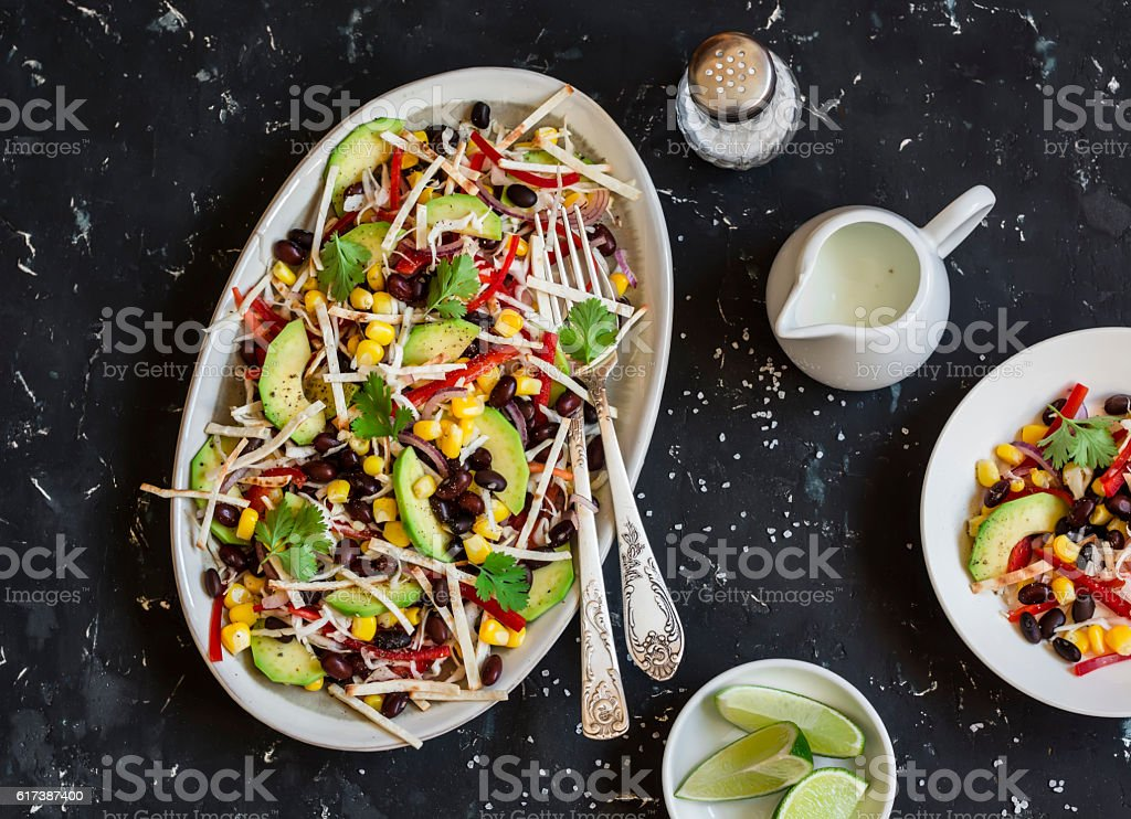 Salad with corn, beans, avocado and tortilla stock photo